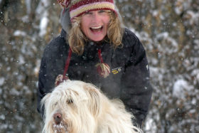 CALGARY SUN PHOTO  Pat Salt try's to give her pooch Vada (4 yrs) some help crossing the deep snow as she has no problem with her new snow shoes near their home in NE Calgary .STUART DRYDEN/QMI Agency